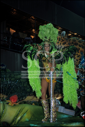 Rio de Janeiro, Brazil. Carnival: Portela samba school passistas in green costume with feathers - Miss World 2001.