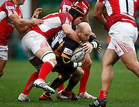 Photo: Richard Lane/Richard Lane Photography. London Wasps v London Welsh. 28/10/2012. Wasps' Joe Simpson is tackled.