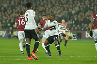 Jean Michaël Seri of Fulham is tackled by Declan Rice of West Ham United during West Ham United vs Fulham, Premier League Football at The London Stadium on 22nd February 2019