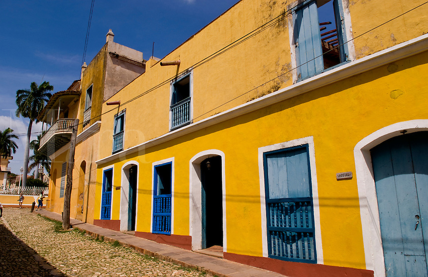Old yellow building in colonial town of Trinidad Cuba