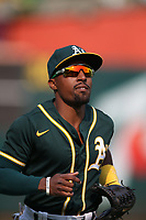 OAKLAND, CA - SEPTEMBER 25:  Tony Kemp #5 of the Oakland Athletics runs off the field in between innings against the Houston Astros during the game at the Oakland Coliseum on Saturday, September 25, 2021 in Oakland, California. (Photo by Brad Mangin)