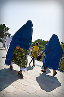 The full Afghan chadri (otherwise known as burqa) covers the wearer's entire face except for a small region about the eyes, which is covered by a concealing net or grille.<br /> <br /> Before the Taliban took power in Afghanistan, the chadri was infrequently worn in cities. While they were in power, the Taliban treatment of women required the wearing of a chadri in public. Officially, it is not required under the present Afghan regime, but its use is variable over the country.