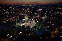 Beautiful Aerial View from a helicopter of the Texas State Capitol, Government building lit up at night before a vibrant sunset in Austin, Travis County, Texas, USA