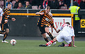 "Stirling's Lewis Coult gets a grip off Alloa""s Greig Spence."