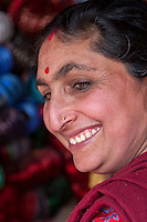 Nepal, Patan.  Nepalese Woman with Bindi between eyebrows, tika in parting of the hair, and a nose ring.