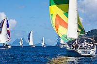 Yachts racing in the third leg of the Tahiti Pearl Regatta, racing around Tahaa Island in the lagoon