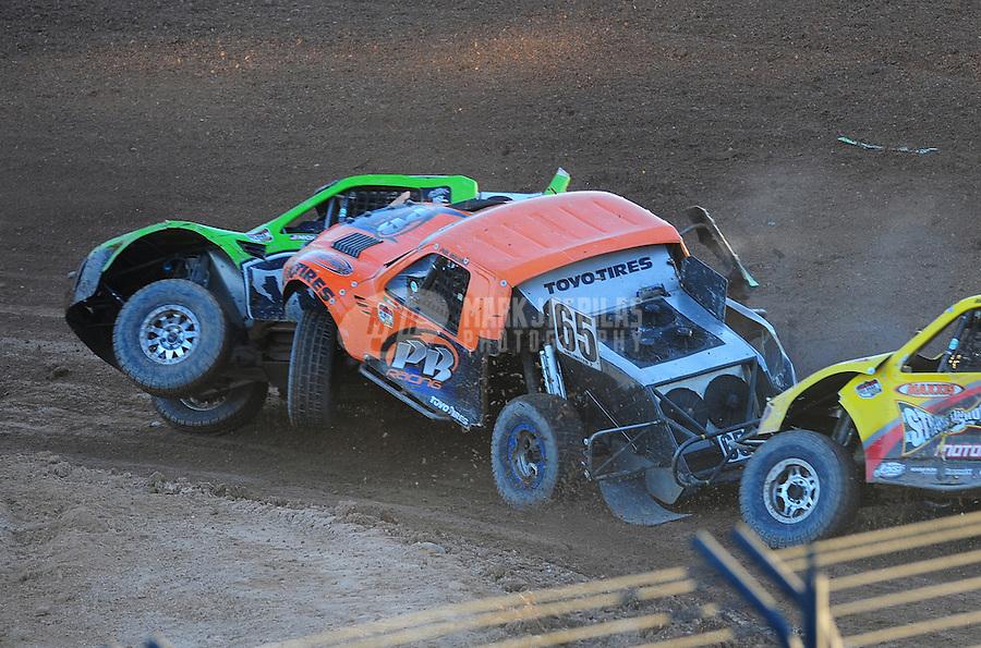 Dec. 10, 2011; Chandler, AZ, USA;  LOORRS pro 2 unlimited driver Nick Tyree (91) and Phil Bollman (65) during round 15 at Firebird International Raceway. Mandatory Credit: Mark J. Rebilas-