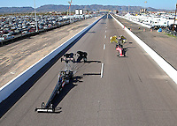Feb 21, 2014; Chandler, AZ, USA; NHRA top fuel dragster driver Terry McMillen (left) and Leah Pritchett during qualifying for the Carquest Auto Parts Nationals at Wild Horse Pass Motorsports Park. Mandatory Credit: Mark J. Rebilas-USA TODAY Sports