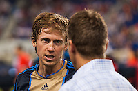 Brian Carroll (7) of the Philadelphia Union talks with manager John Hackworth prior to playing the New York Red Bulls. The New York Red Bulls and the Philadelphia Union played to a 0-0 tie during a Major League Soccer (MLS) match at Red Bull Arena in Harrison, NJ, on August 17, 2013.