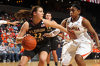 Feb. 7, 2011; Charlottesville, VA, USA; Florida State Seminoles guard Olivia Bresnahan (22) handles the ball next to Virginia Cavaliers guard Ariana Moorer (15) during the second half of the game at the John Paul Jones Arena. The Florida State Seminoles won 78-74. Mandatory Credit: Andrew Shurtleff-US PRESSWIRE