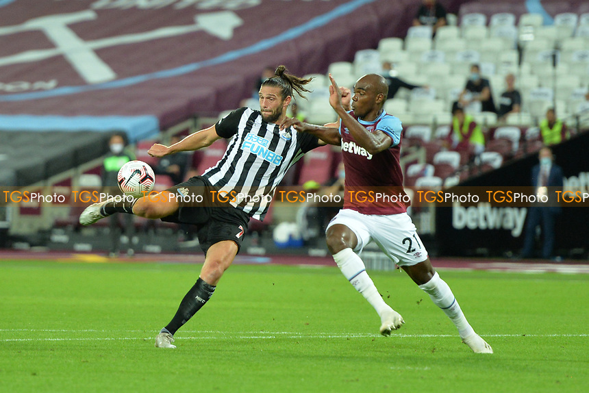 Andy Carroll of Newcastle United shot is blocked by Angelo Ogbonna of West Ham Unitedduring West Ham United vs Newcastle United, Premier League Football at The London Stadium on 12th September 2020