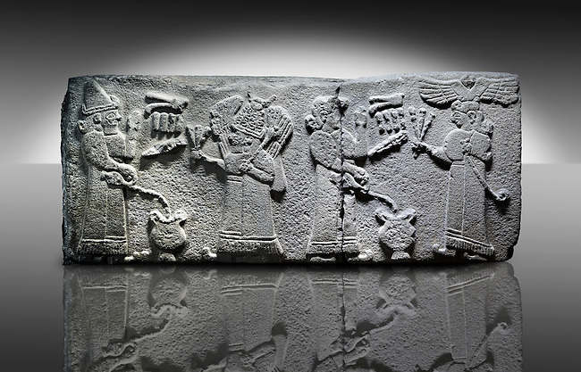 Picture & image of a Neo-Hittite orthostat with a releif sculpture a libation for the gods from Aslantepe ,  Malatya, Turkey.  The figure on the far left is beleived to be a king. He is facing a Bearded God wearing a bore tusk helmet. The God is holding a 3 pronged object and has a club resting on his shoulder. The 2 shaven characters on the right are mirror images of the two figures on the right except this time the king is on the far right waering a winged sun disc headress and holding a Lituus. The epigraphs identify the king and the cresent on the beared gods helmet identify him as Pugnus Mili The Sum and Moon God. An Ankara Museum of Anatolian Civilizations exhibit.