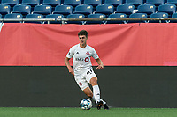 FOXBOROUGH, MA - JULY 23: Themi Antonoglou #81 of Toronto FC II dribbles during a game between Toronto FC II and New England Revolution II at Gillette Stadium on July 23, 2021 in Foxborough, Massachusetts.