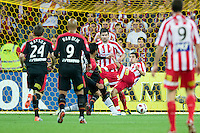 MELBOURNE, AUSTRALIA - NOVEMBER 19: Marcos Flores of Adelaide kicks for goal in action during the round 15 A-League match between the Melbourne Heart and Adelaide United at AAMI Park on November 19, 2010 in Melbourne, Australia (Photo by Sydney Low / Asterisk Images)