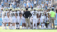 CHAPEL HILL, NC - NOVEMBER 14: Wake Forest defensive huddle during a game between Wake Forest and North Carolina at Kenan Memorial Stadium on November 14, 2020 in Chapel Hill, North Carolina.