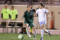 Karen Carney (white) takes the ball pass Angie Woznuk..Saint Louis Athletica were defeated 1-0 by Chicago Red Stars.