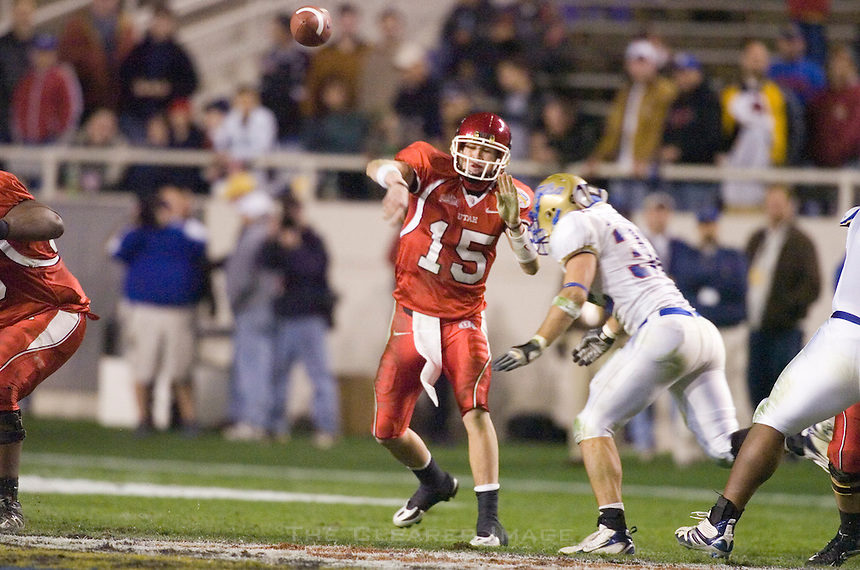 23 December 2006: Utah quarterback Brent Ratliff (#15) hurls a pass during the 2006 Bell Helicopters Armed Forces Bowl between The University of Tulsa and The University of Utah at Amon G. Carter Stadium in Fort Worth, TX.