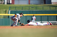 Salt River Rafters second baseman Bryson Brigman (15), of the Miami Marlins organization, applies the tag to the hand of Jahmai Jones (9) as he slides into second base on a stolen base attempt during an Arizona Fall League game against the Mesa Solar Sox at Sloan Park on November 9, 2018 in Mesa, Arizona. Mesa defeated Salt River 5-4. (Zachary Lucy/Four Seam Images)