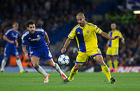Gal Alberman of Maccabi Tel Aviv holds off Cesc Fabregas of Chelsea during the UEFA Champions League match between Chelsea and Maccabi Tel Aviv at Stamford Bridge, London, England on 16 September 2015. Photo by Andy Rowland.