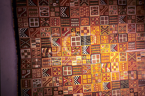 Lima, Peru. Inca woven textile with stylised geometric design. The Gold Museum.