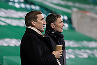 15th November 2020; Easter Road, Edinburgh, Scotland; Scottish League Cup Football, Hibernian versus Dundee FC; Hibs 2016 cup winning manager Alan Stubbs watches the match with TV pundit and fellow former England Internationalist Chris Sutton
