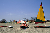 Banjul, The Gambia. Boats for hire to tourists on the beach; sailing dinghy, pedalo, canoes.