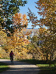 A bike rider on the riverfront trails along the Clark Fork River in downtown Missoula, Montana