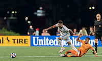 FOXBOROUGH, MA - JUNE 29: Juan Agudelo #17, Darwin Ceren #24 battle for the ball during a game between Houston Dynamo and New England Revolution at Gillette Stadium on June 29, 2019 in Foxborough, Massachusetts.