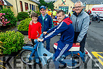 Maoilseachlainn and Michael Warr from Tralee, James O'Brien and Conor Fitzgerald from Blennerville on the motorbike at the West Kerry Honda 50 and Classic Bike Run in aid of the Kerry Hospice in Blennerville on Sunday.