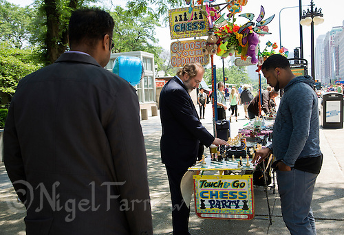 26 JUN 2014 - CHICAGO, USA - People play chess at a stand on South Michigan Avenue in Chicago in the USA (PHOTO COPYRIGHT © 2014 NIGEL FARROW, ALL RIGHTS RESERVED)