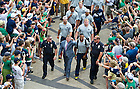 Aug. 31, 2013;  Head coach Brian Kelly signals number one as he enters Notre Dame Stadium with players before the season opener against Temple. Photo by Barbara Johnston/University of Notre Dame