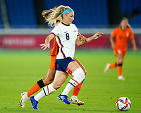 YOKOHAMA, JAPAN - JULY 30: Julie Ertz #8 of the United States battles for the ball during a game between Netherlands and USWNT at International Stadium Yokohama on July 30, 2021 in Yokohama, Japan.