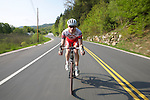Man rides his road bike on a nice summer day in Vermont. 2010.