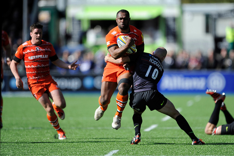 Vereniki Goneva of Leicester Tigers is tackled by Charlie Hodgson of Saracens during the Aviva Premiership Rugby match between Saracens and Leicester Tigers at Allianz Park on Saturday 11th April 2015 (Photo by Rob Munro)