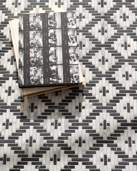 Esparto, a hand-cut tumbled mosiac, shown in Nero Marquina and Calacatta , is part of the Tissé® collection for New Ravenna.