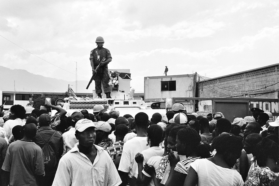 MINUSTAH soldier watching over the crowd of would-be voters outside the closest voting station to Cite Soleil on the day of the elections.