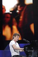 """Yann Perreau performs at the """"Paris-Quebec"""" show of the 44th Festival d'ete de Quebec on the Plains of Abraham in Quebec city Thursday July 7, 2011."""