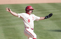 Arkansas outfielder Braydon Webb (8) slides home for a score, Saturday, April 3, 2021 during the ninth inning of a baseball game at Baum-Walker Stadium in Fayetteville. Check out nwaonline.com/210404Daily/ for today's photo gallery. <br /> (NWA Democrat-Gazette/Charlie Kaijo)