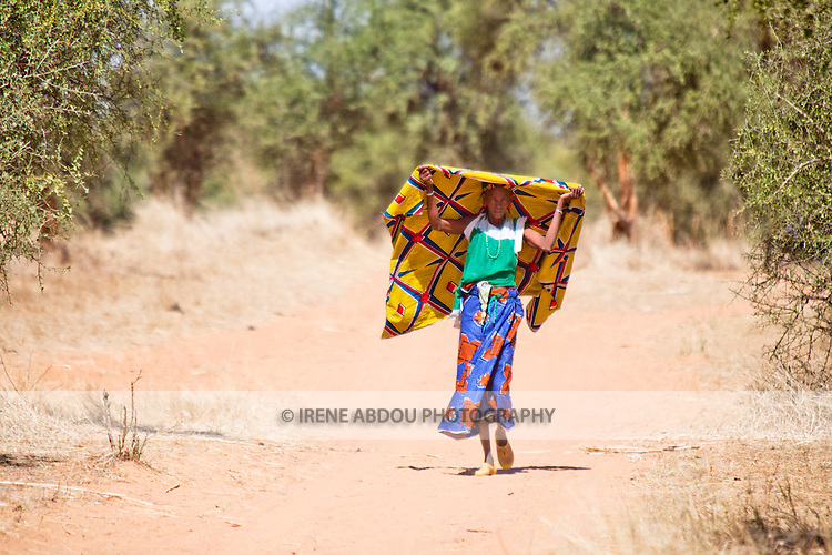 Fulani woman in the village of Bourro in northern Burkina Faso.  The Fulani are traditionally nomadic pastoralists, crisscrossing the Sahel season after season in search of fresh water and green pastures for their cattle and other livestock.
