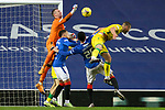 26.12.2020 Rangers v Hibs: Allan McGregor punches clear from Ryan Porteous
