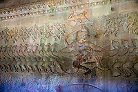 Cambodia, Angkor Wat.  Vishnu on Mount Mandara, leading the gods and the demons in the Churning the Sea of Milk, from the Hindu Creation Myth, the Bhagavata-Purana.  Indra is above Vishnu.  Asuras (demons, evil spirits) are to the left, apsaras dancing above them.  12th. Century.