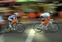Team Jayco's Amanda Spratt (Australia, left) chases NZ's Catherine Cheatley. NZCT Women's Cycling Tour of New Zealand Stage 6 - Criterium at Lambton Quay, Wellington, New Zealand on Sunday, 27 February 2011. Photo: Dave Lintott / lintottphoto.co.nz