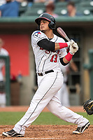 Lansing Lugnuts catcher Andres Sotillo (13) follows through on his swing during the Midwest League baseball game against the Bowling Green Hot Rods on June 29, 2017 at Cooley Law School Stadium in Lansing, Michigan. Bowling Green defeated Lansing 11-9 in 10 innings. (Andrew Woolley/Four Seam Images)