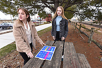 Betty Gower (left), 17, and Grace Henley, 18, talk Saturday Feb. 6 2021 in downtown Rogers about their LGBTQ Rogers High School yearbook proposal.<br />