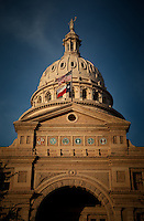 Texas State Capitol building exterior dome closeup with flags at the Texas State Capitol.