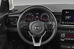 Car pictures of steering wheel view of a 2021 KIA Rio More 5 Door Hatchback Steering Wheel