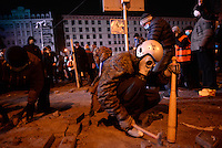 Rioters dismantle the pavement to pull off the tiles and throw them  against the riot police during the   protest against new draconian law to ban the right to  protest across the country.  Kiev. Ukraine