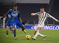 3rd January 2021, Allianz Stadium, Turin Piedmont, Italy; Serie A Football, Juventus versus Udinese; Cristiano Ronaldo R of Juventus crosses past Walace of Udinese
