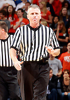 CHARLOTTESVILLE, VA- NOVEMBER 29: A referee makes a call during the game on November 29, 2011 at the John Paul Jones Arena in Charlottesville, Virginia. Virginia defeated Michigan 70-58. (Photo by Andrew Shurtleff/Getty Images) *** Local Caption ***