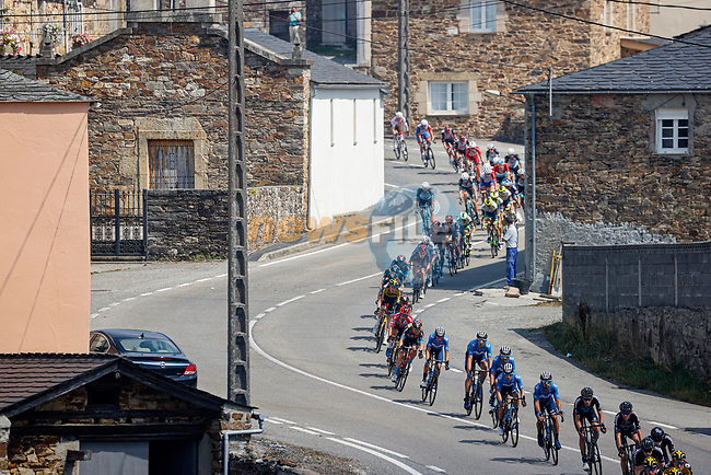 The peloton lined out during Stage 19 of La Vuelta d'Espana 2021, running 191.2km from Tapia de Casariego to Monforte de Lemos, Spain. 3rd September 2021.    <br /> Picture: Luis Angel Gomez/Photogomezsport | Cyclefile<br /> <br /> All photos usage must carry mandatory copyright credit (© Cyclefile | Luis Angel Gomez/Photogomezsport)
